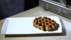 Waffles are taken from a waffle iron / cooked waffles. Cooked waffles, baking dough for waffles