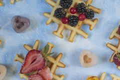 Waffles. Top view of waffles decorated with berries Royalty Free Stock Image
