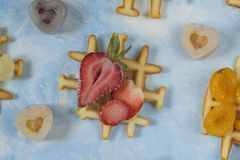 Waffles. Top view of waffles decorated with berries Stock Photos
