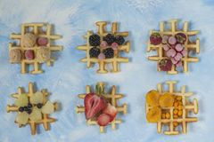 Waffles. Top view of waffles decorated with berries Stock Image