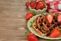 Waffles with topping and strawberries Royalty Free Stock Image