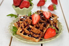 Waffles with topping and strawberries Stock Image