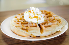 Waffles under the caramel topping Royalty Free Stock Photo