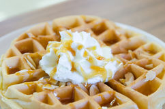 Waffles under the caramel topping with cream on top Stock Photo