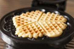Waffles. With a waffle iron Royalty Free Stock Photos