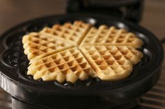 Waffles. With a waffle iron Royalty Free Stock Photo
