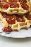 Waffles. With jam from a plum on a white plate Stock Image