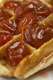 Waffles. With jam from a plum on a white plate Royalty Free Stock Images