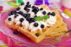 Waffles with whipped cream and blueberries Royalty Free Stock Image