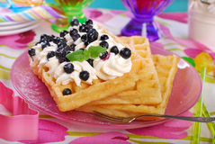 Waffles with whipped cream and blueberries Royalty Free Stock Images