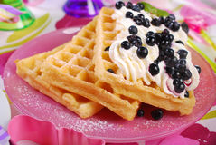 Waffles with whipped cream and blueberries Royalty Free Stock Photo