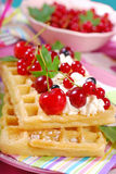 Waffles with whipped cream and fresh summer fruits Royalty Free Stock Photos