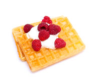 Waffles with whipped cream and raspberrries Royalty Free Stock Images