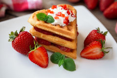 Waffles with whipped cream and strawberries Stock Images