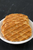 Waffles in white plate on black Royalty Free Stock Photos