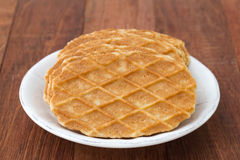 Waffles in white plate on brown Stock Images