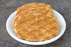 Waffles in white plate on dark Stock Photos