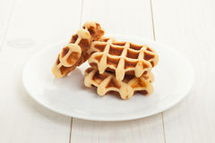 Waffles on white plate Stock Photos