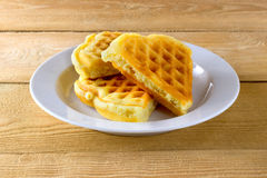 Waffles on a white plate. And wooden background Stock Photography