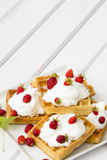 Waffles with wild strawberries and whipped cream Royalty Free Stock Photos