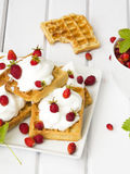 Waffles with wild strawberries Stock Photography