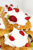 Waffles with wild strawberries and whipped cream Royalty Free Stock Photo