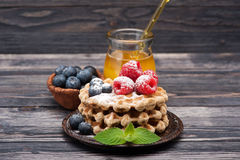 Waffles With Blueberries, Raspberries And Honey. Royalty Free Stock Photos