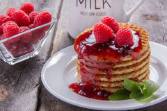 Free Waffles With Raspberries And Jam For Breakfast On A Wooden Table Stock Images - 74219464