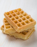 Waffles on wooden table Stock Image