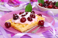Waffles with yogurt with fresh cherries Royalty Free Stock Photography