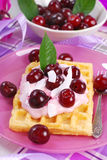 Waffles with yogurt with fresh cherries Royalty Free Stock Photos