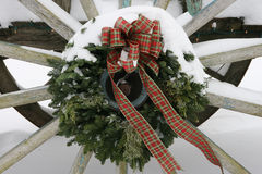 Wagaonwheel wreath with Snow Stock Images