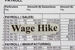 Wage hike Stock Photo