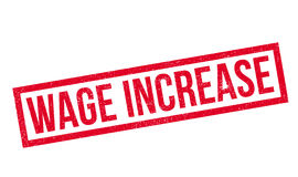Wage Increase rubber stamp Stock Photo