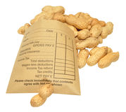Wage Packet And Peanuts Royalty Free Stock Photo