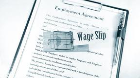 Wage slip. And a mouse trap on employment contract Stock Image