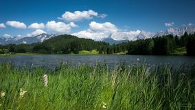 Wagenbruchsee with alp mountains in Germany time-lapse stock video