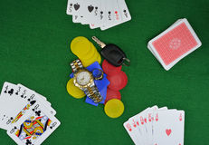 Wagering on poker cards desperately Royalty Free Stock Images