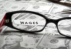 Wages. Business office wages concept with us currency Royalty Free Stock Image