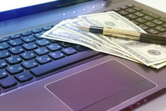 Wages money. Laptop with a salary on it. Embodies the work and encouragement for her stock image
