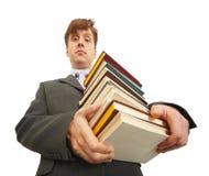 Waggish man holding pile of textbooks Royalty Free Stock Photo