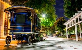 Waggon Kiosk on Sidewalk. Retro blue waggon kiosk on new sidewalk, Bucharest Royalty Free Stock Images