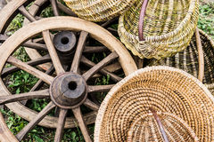 Waggon wheels and wicker baskets at a country fair Stock Image