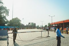 WAGHA BORDER, AMRITSAR, PUNJAB, INDIA - JUNE, 2017. People going to attend lowering of flags ceremony. Its a daily military practi royalty free stock images
