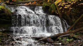 Wagner Falls Loop. Whitewater flows over Wagner Falls, a beautiful waterfall near Munising in Michigan's Upper Peninsula in the autumn. Video loops seamlessly stock video footage