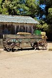 Wagon, antique in the desert in Queen Creek, Arizona, United States. Natural wood with blue-green paint antique wagon, located in the desert in Queen Creek stock photo