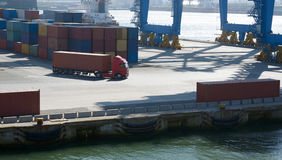 Wagon carries a large container in  port terminal Stock Photo