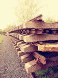 Wagon with extracted old railways. Concrete and wooden sleepers with rail rods Stock Photo