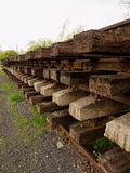 Wagon with extracted old railways. Concrete and wooden sleepers with rail rods Royalty Free Stock Photography