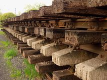 Wagon with extracted old railways. Concrete and wooden sleepers with rail rods Stock Photos